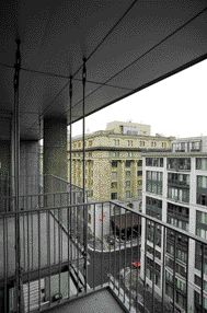 A Dialogue Between the Project and Its Context Can Be Seen From One of the Suspended Balconies That Overlooks Rue McGill.