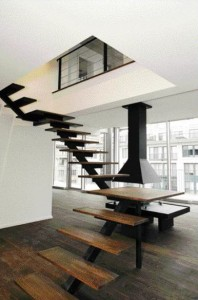The Absence of Balustrades Lends a Wonderful Floating Sensation to the Sculptural Presence of the Open-Riser Stairs.