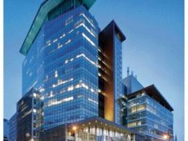 Le Quartier Concordia (2005) Creates a Transparent but Deliberate Urban Corner Condition in Downtown Montreal.