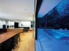 ...and a Sliding Window Wall That Connects the Dining Room With the Outdoor Lap Pool.