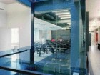 Light and Transparency Animate the James Stewart Centre for Mathematics at Mcmaster University (2003). Right