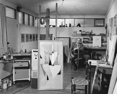 Surrounded by Paintbrushes, Canvas and Other Tools of His Trade, Artist B.C. Binning Is Seated in His Home Studio in This Photograph From 1950.