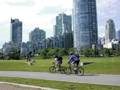 Taking a Leisurely Bike Ride Along the Seawall in False Creek Against a Rapidly Densifying Condoscape.
