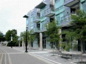 The Podiums of Vancouver's Towers are Often Devoted to Ground-Oriented Townhouses, or to Shops and Commercial Businesses.