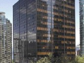 """Formerly Known as the West Coast Transmission Tower, """"The Qube"""" Is a Successful Project Responding to a Worrying Trend: Downtown Office Space Changing Over to Residential Use. The Building Was Originally Designed in 1969, and Allowed Pedestrians to Retain a View of the North Shore Beyond."""