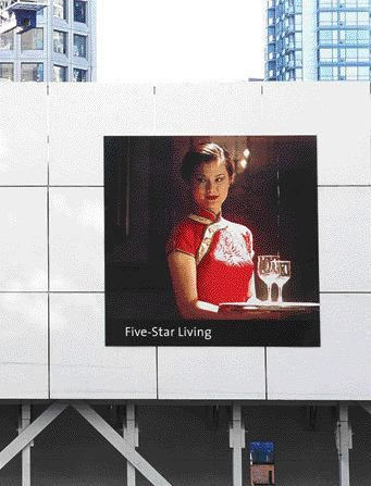 Enlarged Photographic Images From the Shangri-La Condominium Marketing Campaign Adorn Construction Hoarding Along Georgia and Alberni Streets, Enticing Passersby With the Promise of Hedonistic Luxury.