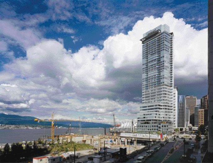 Realization of the Shaw Tower Required the Enlargement of the Restrictive Site Through the Construction of New Concrete Decking, Thereby Extending Vancouver's Existing Waterfront.