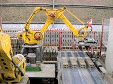 Japanese Robots Lift and Set the Pressed Brick Onto Kiln Cars for Firing