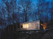 Sunset Cabin Becomes a Lantern at Night, a Glowing Ember Perched at the Edge of Lake Simcoe.
