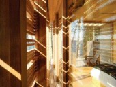 A Photograph of the Space Between the Cedar Screen and the Glass-Enclosed Cabin Reveals the Effect of the Stunning Patterns and Bands of Late-Day Sun and Shadow