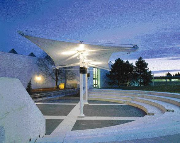 Dramatic Uplighting Enhances the Taut Fabric Canopy of the Humber Students' Federation Amphitheatre at Dusk.
