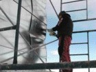 A University of Calgary Architecture Student Puts Some Finishing Touches on the Building Envelope.