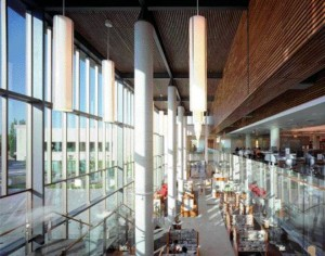 Inside the North Atrium, Patrons Can Appreciate a Clear View Toward the Plaza While Elongated Light Fixtures Accentuate the Room's Height.