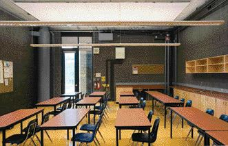 A Typical Classroom, Furnished With Simple Millwork and Finished With Exposed Concrete Block.
