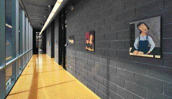 Student Artwork Lines This Cheerful School Corridor.
