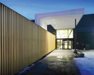 With An Illuminated Wood Screen and An Open-Ended Canopy to Welcome Students, the College of New Caledonia Belies Its Roots as An Old Canadian Tire Outlet.