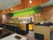 Conveying the Concept of Rind/Peel/Husk, the Interior of Vegan Restaurant Fresh Reveals a Highly Textural and Multi-Layered Material Palette of Rough Exposed Brick, Glass Mosaic Tile, Plastic Laminate, Leaf-Patterned Wallpaper, and Shiplapped Douglas Fir Panelling.