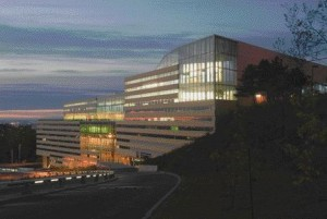Viewed at Dusk, the Building's East Elevation Reveals Its Gigantic Mass Rising From Its Sloping Site.