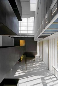 Layers of Encroaching Solid Forms in the Atrium Space Include the Dominant Bridge to the Theatre.