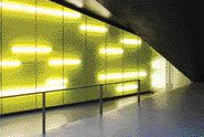 Yellow Fluorescent Tubes Cast An Eerie Glow on the Wall to Enhance Passage Up and Down the Adjacent Stair.