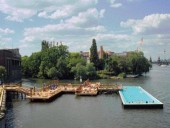 An Overall View of the Popular Riverside Swimming Pool Created From a Converted Shipping Barge.