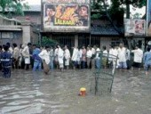 Queuing Up for a Bollywood Film After the Annual Monsoons Flood Mumbai.