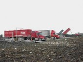 Once the most exclusive hauler for the Greater Toronto Area, Wilson Logistics trucks line up at the tipping scales of the offloading face at Carleton Farms