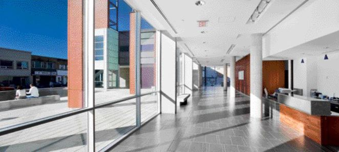 The glazed wall running the entire length of the elegant civic lobby connects the interior space with the outdoor plaza, and provides views of downtown East Main Street.