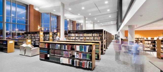 The library's main double-height space contains the majority of the library's collection, with direct visual access to the canal
