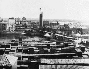 A view of the E.B. Eddy lumber yard in the 1920s with the digester tower in the distance.