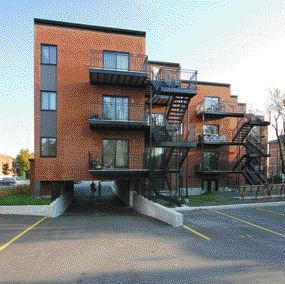 For les Habitations Joseph-Le Caron, Montreal's traditional vocabulary of exterior steel stairs inspired the treatment for the project's rear elevations.