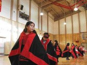 Three views of life at the Bella Bella Community School on Campbell Island include a young Heiltsuk girl participating in a traditional dance with her classmates, a playground, and a computer lab.