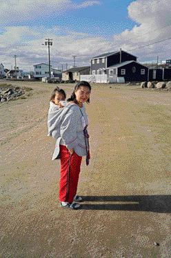 An Innu woman with a child poses in Iqualuit.