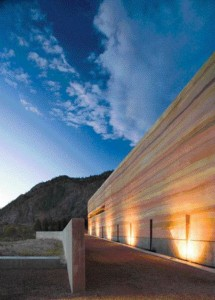 Sited Alongside a Desert Stream, a Terrace and Walkway Lead Into the Cultural Centre as Dusk Approaches.