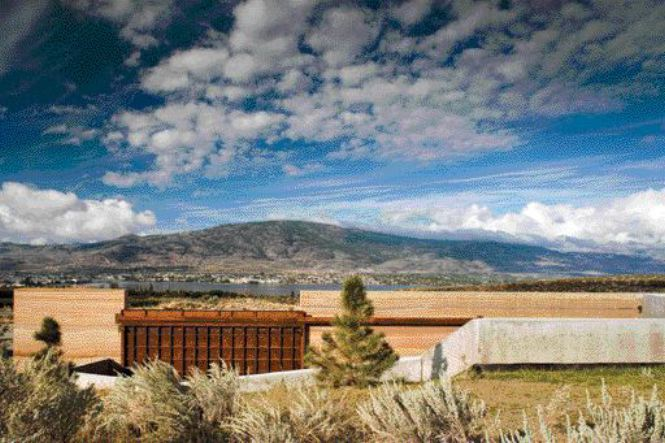 The Rich Colour of Cor-Ten Steel Complements the Warm Tones of the Rammed-Earth Wall While Anticipating the Aesthetic of An Ageless Ruin in a Desert Landscape. Lake Osoyoos Can Be Seen in the Distance.