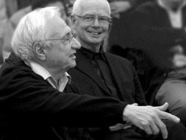 Richards (right) shares a moment with architect Frank Gehry