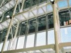 An interior view of the south-facing atrium illustrating the integration of PV panels into the curtain wall
