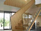 As a sculptural entity in the centre of the house, the stair defines the spaces of the ground-floor open plan.