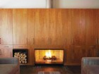 As part of the 52-FOOT-long continuous piece of cherry cabinetry containing bookshelves and storage, a central hearth staves off any dampness from the Maritime winters.