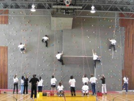 In the gymnasium, students eagerly make use of the rock-climbing wall which is angled at a subtle 10 degrees.