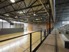 The interior of the gymnasium is well lit by the generous provision of clerestory and ground-level glazing.