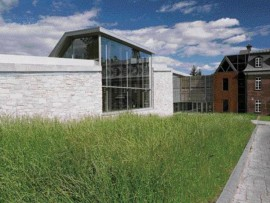 Sited on the Trait-Carr, an important historic site in Quebec City, the Charlesbourg Library's stone walls and sloping roofline formally evoke the region's old farm buildings and agricultural history.
