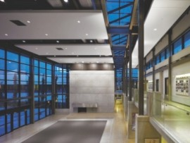 Framed By Steel Columns, The Main Assembly Hall Provides A Juncture Point Between The Facility's Offices And Training Areas.