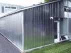CLAD IN GALVALIUME, THE LIVING AND DINING AREA EXUDES A NEARLY GARDEN SHED UTILITARIAN QUALITY