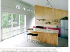 THE KITCHEN IN THE CALLARD HOUSE IS SIMPLY DETAILED WITH PLYWOOD AND IKEA-MADE FIXTURES.
