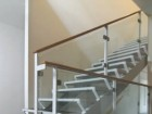 THE WHITE-PAINTED STEEL STAIRCASE IS ONE OF THE FREEN HOUSE'S MOST SIGNIFICANT DESIGN FLOURISHES;