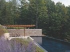 ADJACENT TO THE MEADOW, A LAP POOL BENEFITS FROM SOUTHERN EXPOSURE