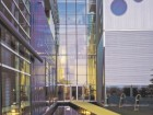 FOR THE MONTREAL STUDIOS AND OFFICES OF THE WORLD-FAMOUS CIRQUE DU SOLEIL (1994-97), HANGANU REVEALED THE BUILDING'S STEEL STRUCTURE THROUGH A THIN SKIN OF GLASS WHILE ALSO INCORPORATING A SERIES OF PLAYFUL CIRCULAR WINDOWS.