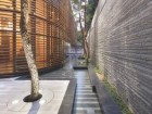 OPPOSITE THE CHANCERY'S TOWER AND STREET-FRIENDLY GROUND FLOOR DEMONSTRATES AN APPROPRIATE MASSING AND ASSEMBLAGE OF MATERIALS THAT ENHANCES THE HISTORIC JEONG-DONG DISTRICT IN WHICH IT IS SITUATED. ABOVE WELL-DETAILED PRIVACY WALLS AND CEDAR SLATS HELP DEFINE A HARMONIOUS AND CONTEMPLATIVE LANDSCAPE FOR THE NEW CHANCERY.