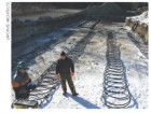 Huge geothermal coils are laid five feet undergroiujnd in a massive geothermal field.